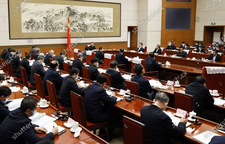 Stock Image of Chinese Premier Li Keqiang, also a member of the Standing Committee of the Political Bureau of the Communist Party of China (CPC) Central Committee, addresses a meeting of the State Council's leading group on the draft formulation of the 14th Five-Year Plan (2021-2025) for National Economic and Social Development in Beijing, capital of China, Dec. 23, 2020. Vice Premier Han Zheng, also a member of the Standing Committee of the Political Bureau of the CPC Central Committee, attended the meeting.