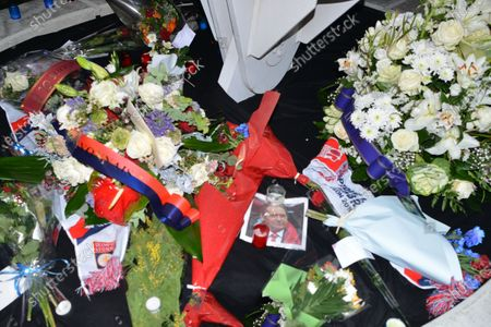 Stock Image of Candles and flowers at the entrance to the lyon stadium in tribute to gerard houllier, former lyon coach before the French league 1  match between Olympique Lyonnais OL  and FC Nantes at Groupama stadium
