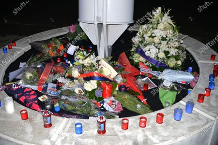 Stock Photo of candles and flowers at the entrance to the lyon stadium in tribute to gerard houllier, former lyon coach before the French league 1  match between Olympique Lyonnais OL  and FC Nantes at Groupama stadium
