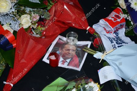 Stock Picture of candles and flowers at the entrance to the lyon stadium in tribute to gerard houllier, former lyon coach before the French league 1  match between Olympique Lyonnais OL  and FC Nantes at Groupama stadium