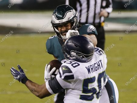 Philadelphia Eagles Richard Rodgers gives a stiff arm to Seattle Seahawks  K.J. Wright in week 12 of the NFL season at Lincoln Financial Field in Philadelphia on Monday, November 30, 2020.
