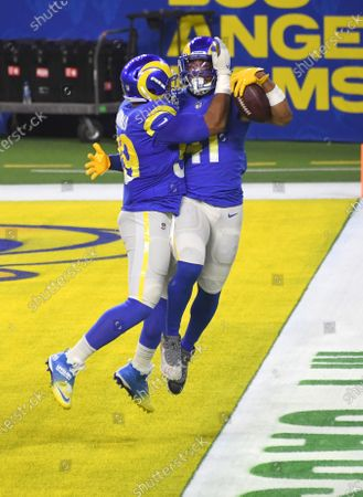 Los Angeles Rams linebacker Kenny Young (R) jumps for joy with teammate Aaron Donald after intercepting New England Patriots quarterback Cam Newton for a touchdown during second quarter action at SoFi Stadium in Inglewood, California on Thursday, December 10, 2020. The Rams beat the Patriots 24-3.
