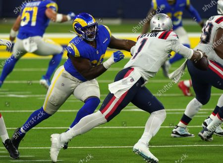 Los Angeles Rams Aaron Donald chases New England Patriots quarterback Cam Newton in second quarter action at SoFi Stadium in Inglewood, California on Thursday, December 10, 2020.
