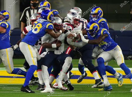 New England Patriots quarterback Cam Newton is tackled by  Los Angeles Rams Justin Hollins(58) short of the goal line in first quarter action at SoFi Stadium in Inglewood, California on Thursday, December 10, 2020.