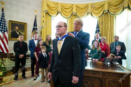 Stock Photo of President Donald Trump presents the Presidential Medal of Freedom to Dan Gable in the Oval Office, Monday, December, 7, 2020.   Gable is a legendary collegiate wrestler and coach from Iowa, and won the 1972 Olympic Gold.    Pool Photo by Doug Mills/UPI