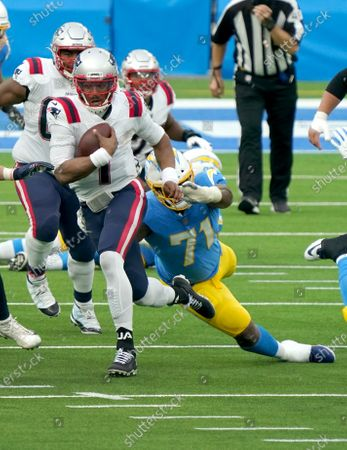 New England Patriots quarterback Cam Newton gets past Los Angeles Chargers nose tackle Damion Square (71) during second quarter action at SoFi Stadium in Inglewood, California on Sunday, December 6, 2020. The Patriots beat the Chargers 45-0.