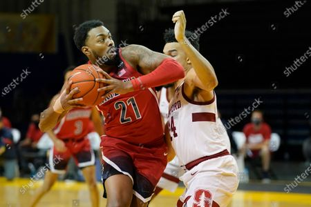 Arizona forward Jordan Brown (21) is defended by Stanford forward Spencer Jones (14) during an NCAA college basketball game in Santa Cruz, Calif