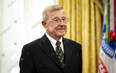 Former college football coach Lou Holtz stands before President Trump presented him with a Medal of Freedom, in the Oval Office at the White House in Washington, DC on Thursday, December 3, 2020. Holtz, the hall of fame college football coach, had a 34 year coaching career that included winning the 1988 national championship with the University of Notre Dame. Holtz coached six different programs to bowl games and four different teams to top 20 final rankings.