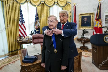 President Donald Trump presents the Medal of Freedom to Lou Holtz in the Oval Office at the White House in Washington, DC on Thursday, December 3, 2020. Holtz, the hall of fame college football coach, had a 34 year coaching career that included winning the 1988 national championship with the University of Notre Dame. Holtz coached six different programs to bowl games and four different teams to top 20 final rankings.