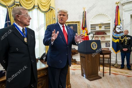 President Donald Trump delivers remarks after presenting the Medal of Freedom to Lou Holtz in the Oval Office at the White House in Washington, DC on Thursday, December 3, 2020. Holtz, the hall of fame college football coach, had a 34 year coaching career that included winning the 1988 national championship with the University of Notre Dame. Holtz coached six different programs to bowl games and four different teams to top 20 final rankings.