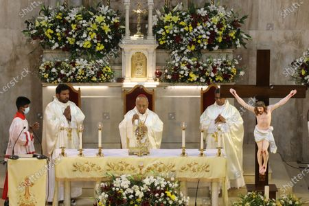 Archbishop of Colombo Cardinal Malcolm Ranjith (C) holds the Christmas Eve midnight mass at the St. Sebastian Church in Kandana suburb of Colombo, Sri Lanka, 24 December 2020. Christians make up seven percent of the 21 million population in the Asian island nation.