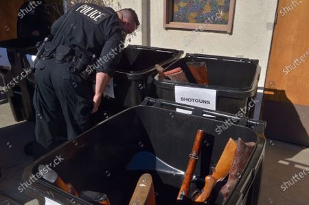 """The Los Angeles Police Department used the annual """"Gun Buy Back"""" program to help reduce gun violence in the city and rally the community around the drive to take more guns off the streets and improve safety in  communities at the Bethel A.M.E. Church in Los Angeles on Saturday, December 5, 2020. """"Every gun recovered in this 'Buy Back' program means one less weapon that can be used to inflict harm,"""" Chief Michael Moore said."""