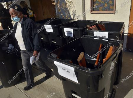 """Stock Picture of The Los Angeles Police Department used the annual """"Gun Buy Back"""" program to help reduce gun violence in the city and rally the community around the drive to take more guns off the streets and improve safety in  communities at the Bethel A.M.E. Church in Los Angeles on Saturday, December 5, 2020. """"Every gun recovered in this 'Buy Back' program means one less weapon that can be used to inflict harm,"""" Chief Michael Moore said."""