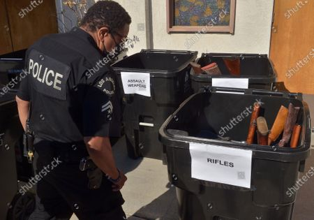"""Stock Image of The Los Angeles Police Department used the annual """"Gun Buy Back"""" program to help reduce gun violence in the city and rally the community around the drive to take more guns off the streets and improve safety in  communities at the Bethel A.M.E. Church in Los Angeles on Saturday, December 5, 2020. """"Every gun recovered in this 'Buy Back' program means one less weapon that can be used to inflict harm,"""" Chief Michael Moore said."""