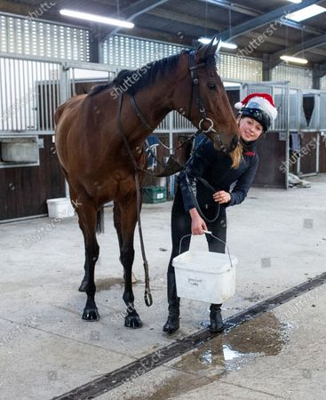 Jaz Jocelyn returns to the stables after Christmas Morning on the Gallops at the racing yard of Andrew Balding at Kingsclere, Berkshire.