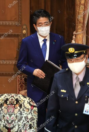 Former Japanese Prime Minister Shinzo Abe arrives at Lower House's house management committee session as he apologizes his false statements to parliament at the National Diet in Tokyo on Friday, December 25, 2020. Prosecutors decided not to indict Abe for his alleged case of illegal payment and prosecutors ended investigation of Abe's scandal.