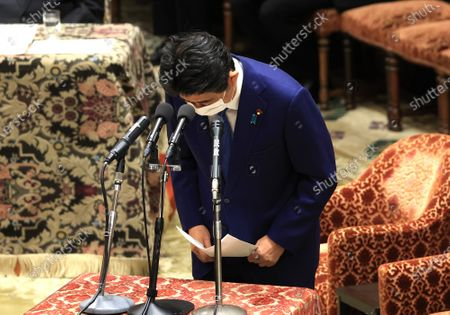Former Japanese Prime Minister Shinzo Abe bows his head as he apologizes his false statements to parliament at Lower House's house management committee session at the National Diet in Tokyo on Friday, December 25, 2020. Prosecutors decided not to indict Abe for his alleged case of illegal payment and prosecutors ended investigation of Abe's scandal.