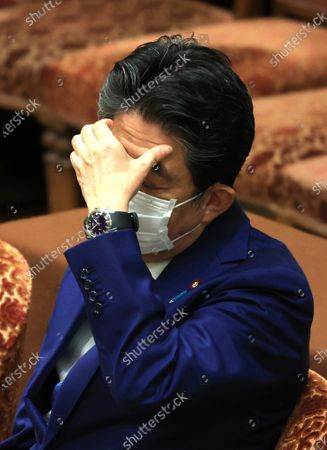Former Japanese Prime Minister Shinzo Abe listens to a question as he apologizes his false statements to parliament at Lower House's house management committee session at the National Diet in Tokyo on Friday, December 25, 2020. Prosecutors decided not to indict Abe for his alleged case of illegal payment and prosecutors ended investigation of Abe's scandal.