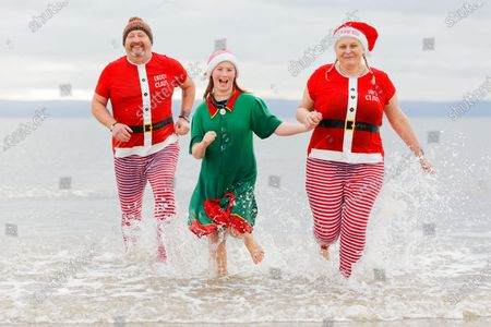 Stock Picture of (L-R) Simon Prosser, Serena Evans, 11 and Beth Prosser take to the sea in Porthcawl