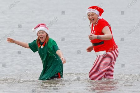 (L-R) Serena Evans and Beth Prosser take to the sea in Porthcawl