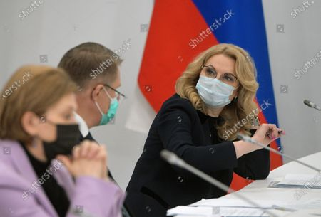 Stock Image of Working visit of Russian Prime Minister Mikhail Mishustin to St. Petersburg. Left to right: Head of the Federal Service for Supervision of Consumer Rights Protection and Human Welfare (Rospotrebnadzor) - Chief State Sanitary Doctor of the Russian Federation Anna Popova, Russian Minister of Health Mikhail Murashko and Deputy Prime Minister of Russia Tatyana Golikova during a meeting of Russian Prime Minister Mikhail Mishustin with manufacturers vaccines against the new coronavirus infection at the Biocad SPC site in Strelna.