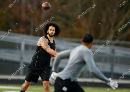 Free agent quarterback Colin Kaepernick participates in a workout for NFL football scouts and media, in Riverdale, Ga. Kaepernick is still blackballed from the NFL four years after protesting racial injustice. In the ultimate hypocrisy, the league has taken up the cause that he championed but clearly has no intention of taking Kaepernick back
