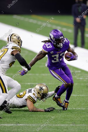 Minnesota Vikings running back Dalvin Cook (33) runs past New Orleans Saints strong safety Malcolm Jenkins (27) and cornerback Marshon Lattimore (23) during an NFL football game, in New Orleans