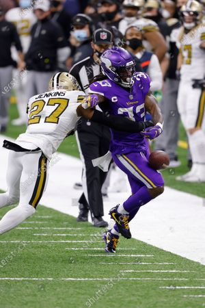 Minnesota Vikings running back Dalvin Cook (33) runs past New Orleans Saints strong safety Malcolm Jenkins (27) (23) during an NFL football game, in New Orleans