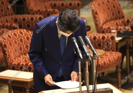 Former Japanese Prime Minister Shinzo Abe bows his head as he apologizes his false statements to parliament at Upper House's house management committee session at the National Diet in Tokyo on Friday, December 25, 2020. Prosecutors decided not to indict Abe for his alleged case of illegal payment and prosecutors ended investigation of Abe's scandal.