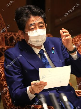 Former Japanese Prime Minister Shinzo Abe listens to a question as he apologizes his false statements to parliament at Upper House's house management committee session at the National Diet in Tokyo on Friday, December 25, 2020. Prosecutors decided not to indict Abe for his alleged case of illegal payment and prosecutors ended investigation of Abe's scandal.