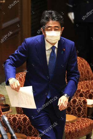 Former Japanese Prime Minister Shinzo Abe answers a question as he apologizes his false statements to parliament at Upper House's house management committee session at the National Diet in Tokyo on Friday, December 25, 2020. Prosecutors decided not to indict Abe for his alleged case of illegal payment and prosecutors ended investigation of Abe's scandal.