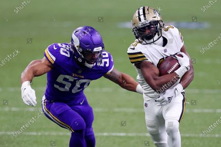 New Orleans Saints wide receiver Emmanuel Sanders (17) carries on a reception against Minnesota Vikings outside linebacker Eric Wilson (50) in the first half of an NFL football game in New Orleans