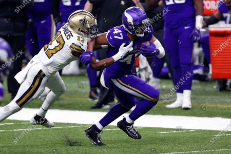 Minnesota Vikings middle linebacker Hardy Nickerson (47) returns an interception on a pass intended for New Orleans Saints wide receiver Emmanuel Sanders (17) in the second half of an NFL football game in New Orleans