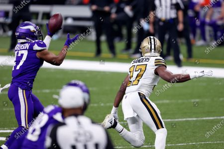Minnesota Vikings middle linebacker Hardy Nickerson (47) intercepts a pass intended for New Orleans Saints wide receiver Emmanuel Sanders (17) in the second half of an NFL football game in New Orleans