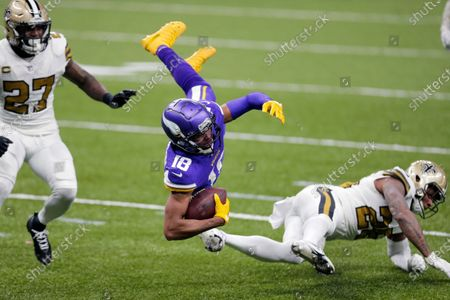 Minnesota Vikings wide receiver Justin Jefferson (18) is tripped up by New Orleans Saints cornerback Ken Crawley as strong safety Malcolm Jenkins (27) defends in the first half of an NFL football game in New Orleans