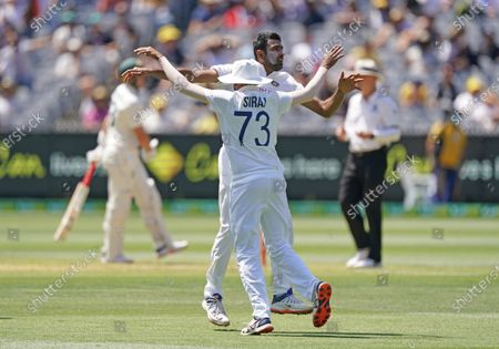 Ravindra Jadeja (R) of India celebrates after dismissing Steven Smith of Australia during day one of the second Test Match between Australia and India at The MCG, Melbourne, Australia, 26 December 2020.