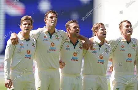 Tim Paine of Australia, Pat Cummins of Australia, Travis Head of Australia, Steven Smith of Australia and Marnus Labuschagne of Australia stand for the national anthem during day one of the second Test Match between Australia and India at The MCG, Melbourne, Australia, 26 December 2020.
