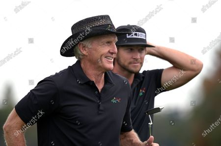Greg Norman, left, of Australia, and his son Greg Norman Jr. walk off the 18th green after finishing during the final round of the PNC Championship golf tournament, in Orlando, Fla