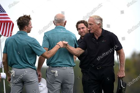 Greg Norman, right, of Australia, and his son Greg Norman Jr., second from right, exchange fist bumps with Tom Lehman and his son Sean Lehman, left, after finishing on the 18th green during the final round of the PNC Championship golf tournament, in Orlando, Fla