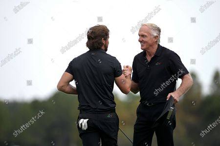 Greg Norman, right, of Australia, embraces his son Greg Norman Jr. after finishing on the 18th green during the final round of the PNC Championship golf tournament, in Orlando, Fla