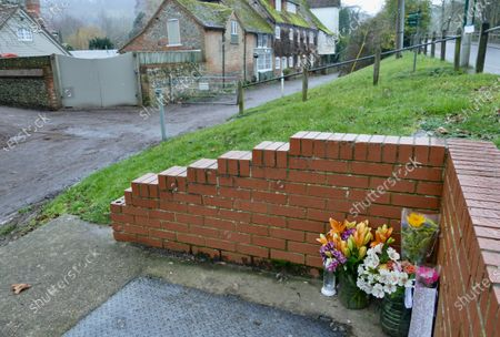 A small amount of tributes are left near to Mill Cottage the former home of George Michael four years after his death on Christmas Day