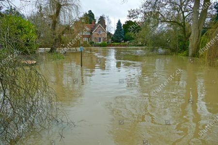 Mill Cottage the former home of George Michael is surrounded by flood waters