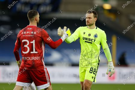 Eupen's goalkeeper Theo Defourny and Club's goalkeeper Simon Mignolet pictured after a soccer match between Club Brugge KV and KAS Eupen, Saturday 26 December 2020 in Brugge, on the nineteenth day of the 'Jupiler Pro League' first division of the Belgian championship.