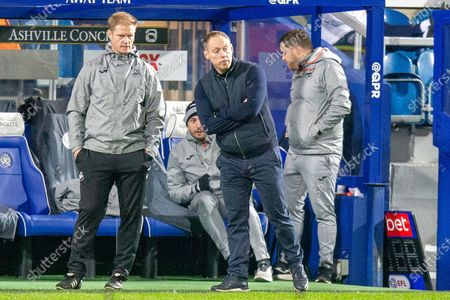 Stock Picture of Swansea City Assistant coach Alan Tate (left) and Swansea City Head Coach Steve Cooper during the EFL Sky Bet Championship match between Queens Park Rangers and Swansea City at the Kiyan Prince Foundation Stadium, London