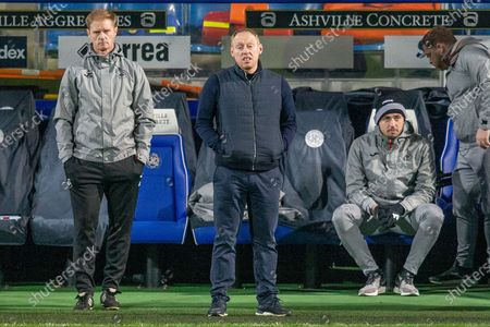 Stock Photo of Swansea City Assistant coach Alan Tate (left) and Swansea City Head Coach Steve Cooper during the EFL Sky Bet Championship match between Queens Park Rangers and Swansea City at the Kiyan Prince Foundation Stadium, London