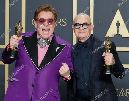 """Elton John (L) and Bernie Taupin, winners of Best Original Song for """"(I'm Gonna) Love Me Again,"""" appear backstage with their Oscars, during the 92nd annual Academy Awards at Loews Hollywood Hotel in the Hollywood section of Los Angeles on Sunday, February 9, 2020. Photo by John Angelillo/UPI"""