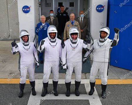 NASA astronauts Shannon Walker, Victor Glover, Mike Hopkins, and Japan Aerospace Exploration Agency (JAXA) astronaut Soichi Noguchi wave as they depart for Launch Complex 39A to board the SpaceX Crew Dragon spacecraft for the Crew-1 mission launch, on November 15, 2020, at NASA's Kennedy Space Center in Florida. NASA's SpaceX Crew-1 mission is the first crew rotation mission of the SpaceX Crew Dragon spacecraft and Falcon 9 rocket to the International Space Station as part of its Commercial Crew Program. Hopkins, Glover, Walker, and Noguchi are scheduled to launch at 7:27 p.m. EST from Launch Complex 39A at the Kennedy Space Center. Photo by Joe Marino/UPI