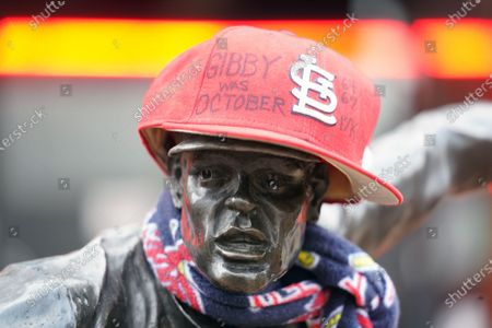 Stock Image of A baseball cap sits atop the statue of former St. Louis Cardinals pitcher and member of the National Baseball Hall of Fame, Bob Gibson, outside of the Busch Stadium in St. Louis as a memorial grows on Saturday, October 3, 2020. Gibson, considered the best Cardinals pitcher of all time, died at the age of 84 in Omaha on October 2, 2020, under hospice care after fighting pancreatic cancer for over a year. Photo by Bill Greenblatt/UPI