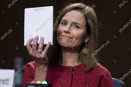 Supreme Court nominee Judge Amy Coney Barrett holds up a blank note pad on the second day of her confirmation hearing before the Senate Judiciary Committee, on Capitol Hill in Washington DC, on Tuesday, October 13, 2020. If confirmed, Barrett will replace Justice Ruth Bader Ginsburg, who died last month. Pool photo by Tom Williams/UPI