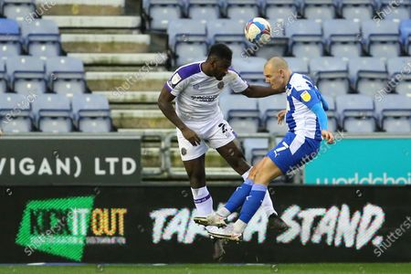 Stock Photo of Wigan's Kal Naismith and Shrewsbury Town's Aaron Pierre during the EFL Sky Bet League 1 match between Wigan Athletic and Shrewsbury Town at the DW Stadium, Wigan